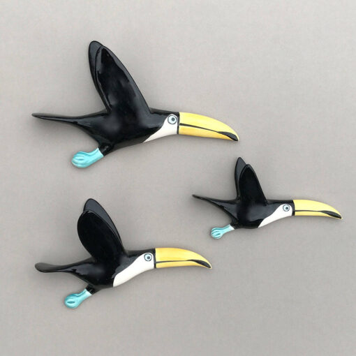 3 flying ceramic toucans