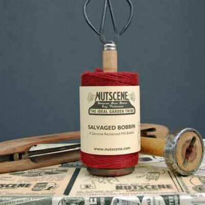 ruby red twine on salvaged mill bobbin with scissors