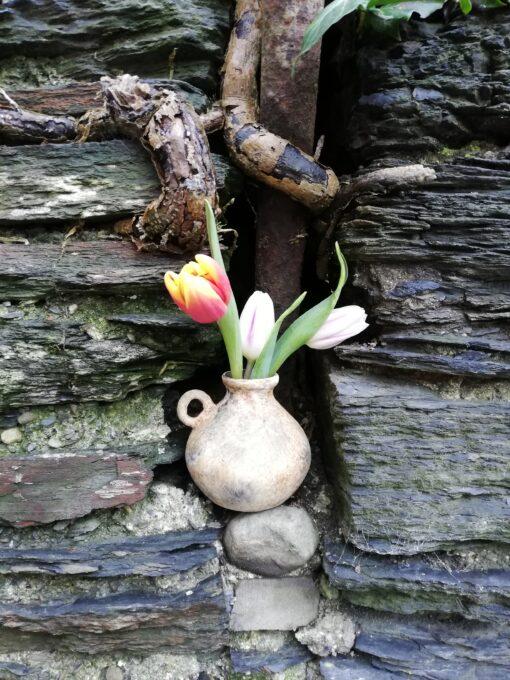 small terracotta vase